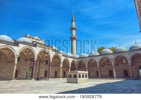 Cortyard of Suleymaniye Mosque with arches in Istanbul Turkey. The mosque was constructed by Sinan for sultan Suleyman the Magnificent