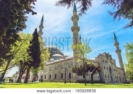 Exterior view of Suleymaniye Mosque through the trees in a garden Istanbul Turkey. The mosque was constructed by Sinan for sultan Suleyman the Magnificent