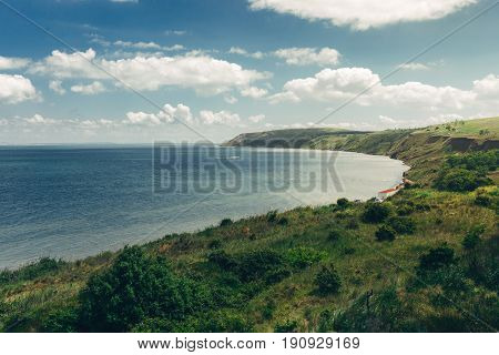 Pcturesque view of rocky promontory that goes to sea on a beautiful sunny day