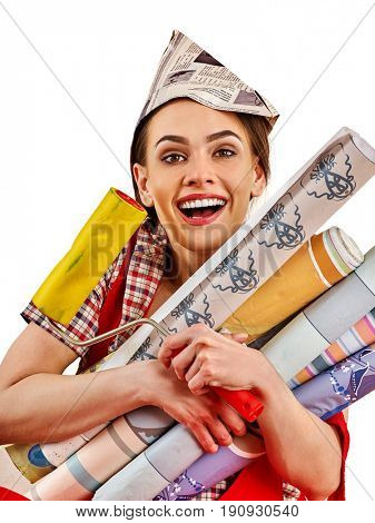 Repair home woman holding paint roller for wallpaper. Aggressive screaming girl in newspaper cap renovation apartment on isolated. Girl is glad to choose right materials. Woman likes repair apartment.