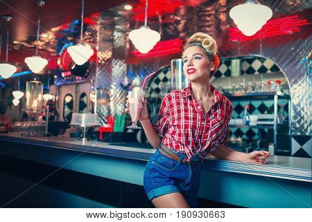 Young pin-up girl in cafe