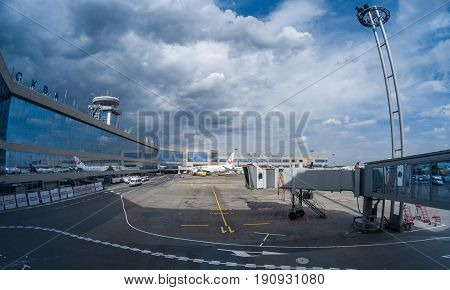MOSCOW, RUSSIA - May 29, 2017: Moscow Domodedovo International airport terminal, passenger airplane, air bridge