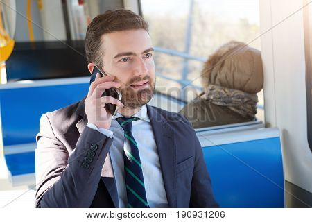 Businessman Commuter Is Traveling And Is Talking