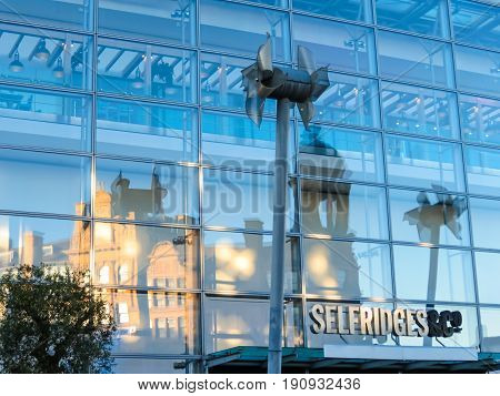 MANCHESTER, UNITED KINGDOM - NOVEMBER 4, 2013: Reflection of the old building The Corn Exchange in windows of modern shopping center. Manchester, England, United Kingdom