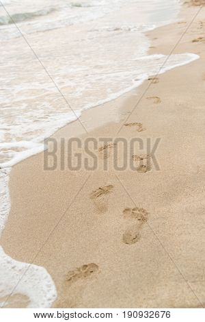 Footsteps In The Sand By The Shore