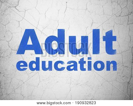 Learning concept: Blue Adult Education on textured concrete wall background