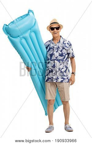Full length portrait of an elderly tourist holding an air pool mattress isolated on white background
