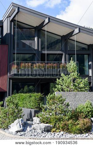 Engelberg, Switzerland - 8 august 2016: Luxurious modern multilevel house front