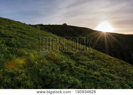 French countryside - Vosges. Sunrise at Hohneck Mountain in the Vosges with view of a mountain hut.