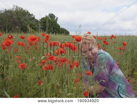 A Middle-aged Woman On A Poppy Field