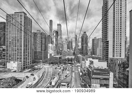 New York City USA - May 26 2017: Cloudy Manhattan seen from aerial tramway going to Roosevelt Island.