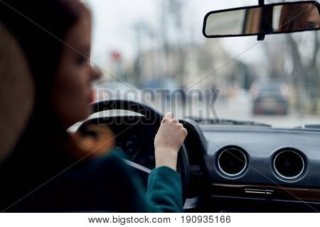 Woman driving a car, a woman is driving in a car.