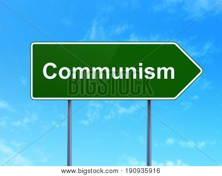 Politics concept: Communism on green road highway sign, clear blue sky background, 3D rendering