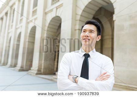 Businessman looking far away