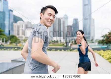Young couple invite friends to run together