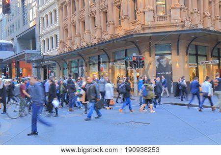 SYDNEY AUSTRALIA - JUNE 1, 2017: Unidentified people cross street in downtown Sydney.