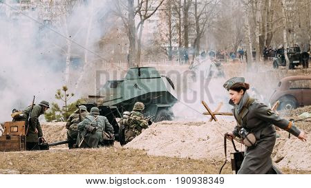 Gomel, Belarus - November 26, 2016: Re-enactors Dressed As German Soldiers In WW II Are Fighting With A Cannon. Celebration Of 73rd Anniversary Of Liberation Of Gomel From Nazi Invaders