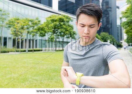 Man using smart watch in city