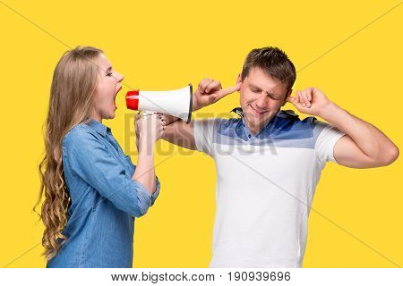 Woman shouting in megaphones with woman at each other