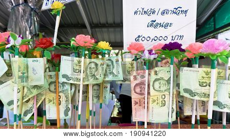 NONTHABURI THAILAND-APRIL13: Donation Merit Money Banknotes on color stick donated by visitors for maintenance the temple on April 13 2017 in NonthaburiThailand.
