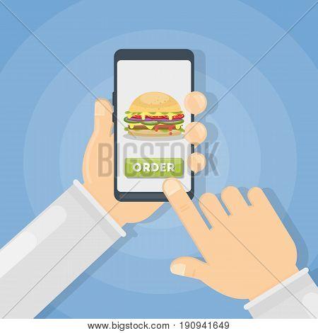 Ordering hamburger through smartphone. Hands holding device.