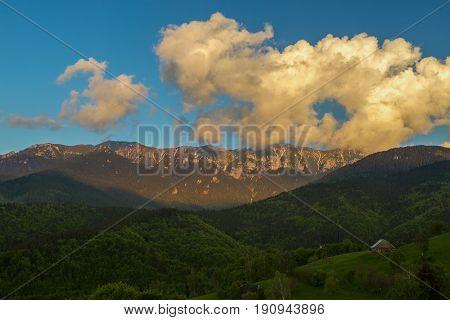 Majestic View With Sunset Light On The Snowy Bucegi Mount Peaks Carpathians Mountains Range Romania.