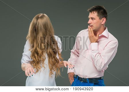 The conflict of couple - Woman shouting to man at studio