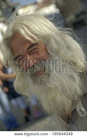Alentejo, Portugal, 26-September-2007: An old man with shiny long hair and a beard smiling for the picture in Alentejo.