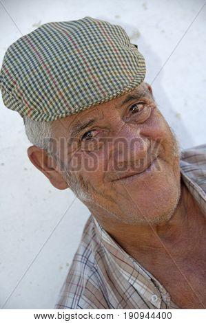 Alentejo, Portugal, 25-September-2007: An old man from Portugal smiling for the picture in Mertola village.