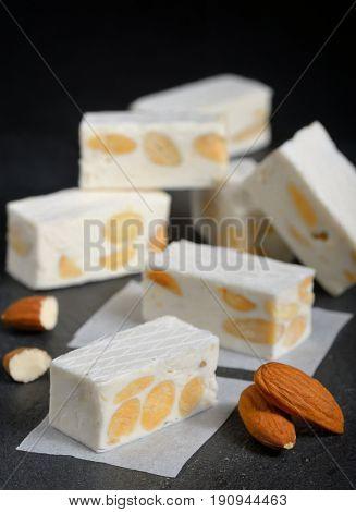 White nougat with almonds on black ardesia plate