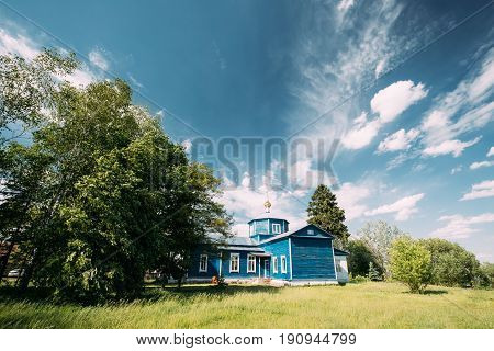Golovintsy, Gomel District, Gomel Region, Belarus. Old Wooden Orthodox Church Of The Protection Of The Holy Virgin, Intercession Church At Sunny Summer Day. Church Of The 19th Century.