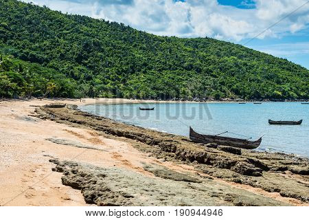 Small traditional pirogue on the shore of Nosy Be island in Madagascar Africa