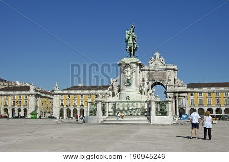 Lisbao, Portugal, 27-September-2007: People walking past an immense memorial statue in Lisbao.