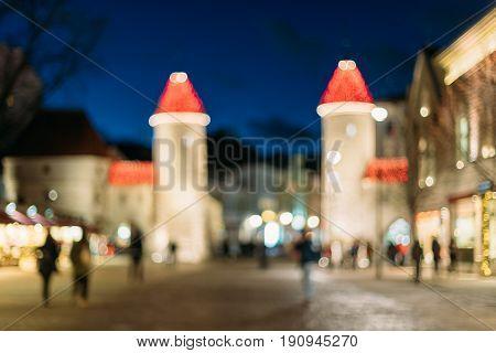 Tallinn, Estonia. Abstract Natural Blurred Boke Bokeh Background Of Landmark Viru Gate In Lighting At Evening Night Illumination. Christmas Xmas New Year Holiday Vacation In Old Town