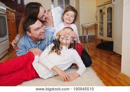 photo of happy family at home on the floor