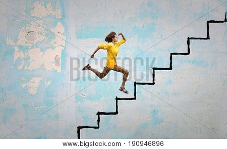 Young woman stepping on a imaginary staircase