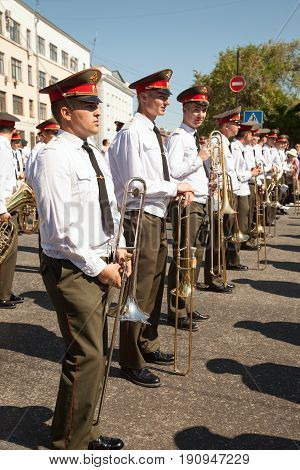 Khabarovsk Russia - May 28 2017: Brass band street performance. Russian musicians in uniform standing in a row are about to play wind instruments on parade. IV international military music festival