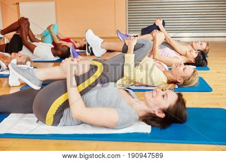 Women making stretching exercise during pilates class at fitness center