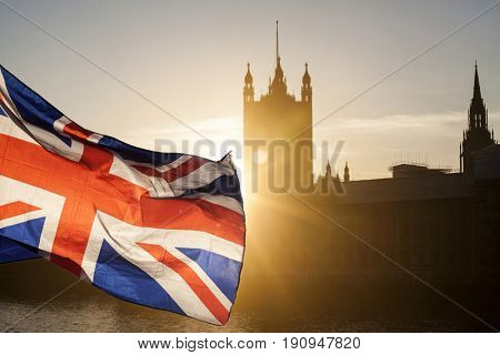 British union jack flag and Big Ben Clock Tower and Parliament house at city of Westminster in the background - UK votes to leave the EU, Brexit concept