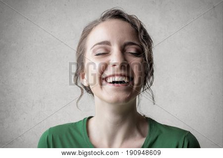 Portrait of laughing fresh faced woman