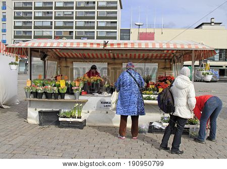 Woman Is Selling Flowers Outdoor In Turku, Finland