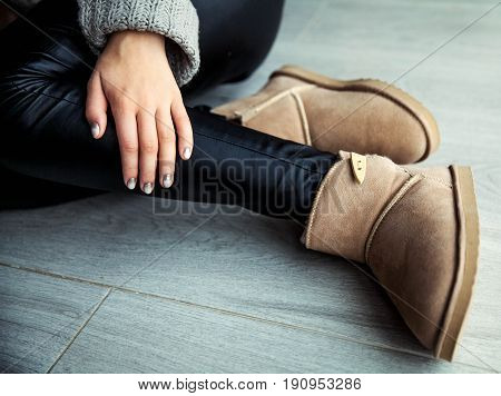 The girl with a nice manicure gray dress ugg boots. Shoes, fashion, style, modern a