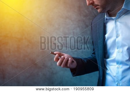 Businessman in hurry received SMS message on smartphone man looking at mobile phone screen