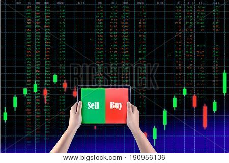 Holding tablet to show screen sell or buy isolated with background stock market graph run number chart business investment and risk exchange background.