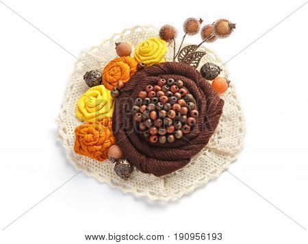 Stylish handmade brooch consisting of brown flowers from fabric on a white background