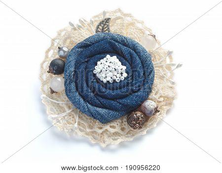 Stylish denim brooch handmade on white background