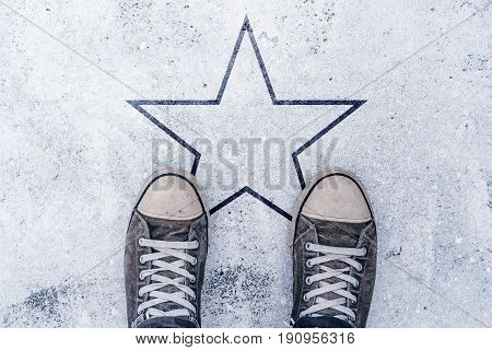 Sneakers on the road with star shape imprint - talent vip prize and award concept