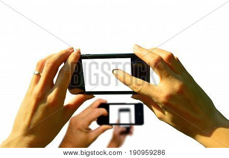 Several hands holding a smartphone high in the air