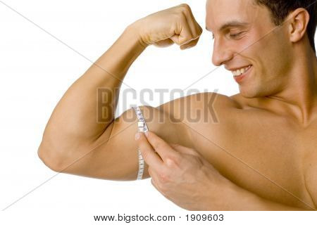 Man'S Mesuring His Biceps
