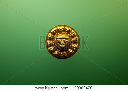 Pre Columbian indigenous golden face from Colombia